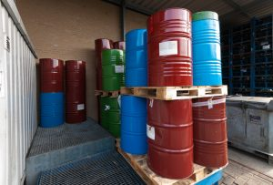 Colored oil barrels stacked on pallets